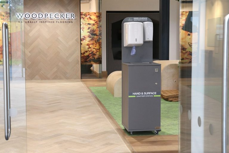 modern grey hand sanitiser station on wheels with touch free dispenser