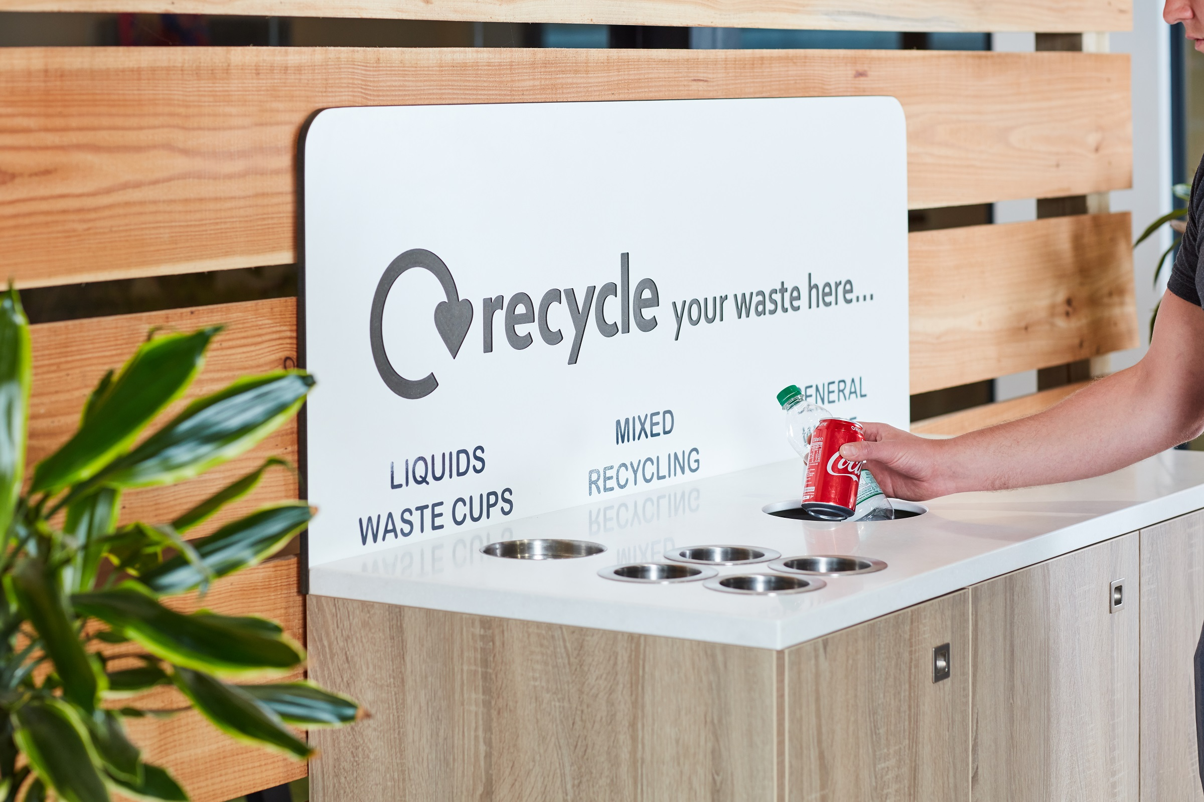 recycling metal cans and plastic bottles to help the environment