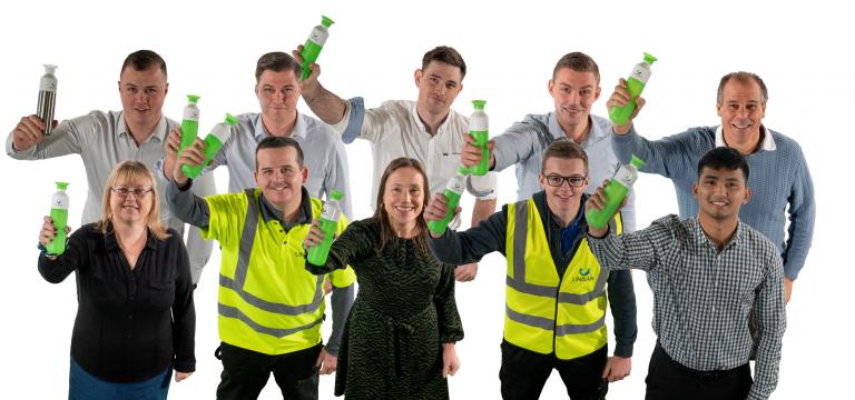 unisan staff with single use drink bottles zerowaste
